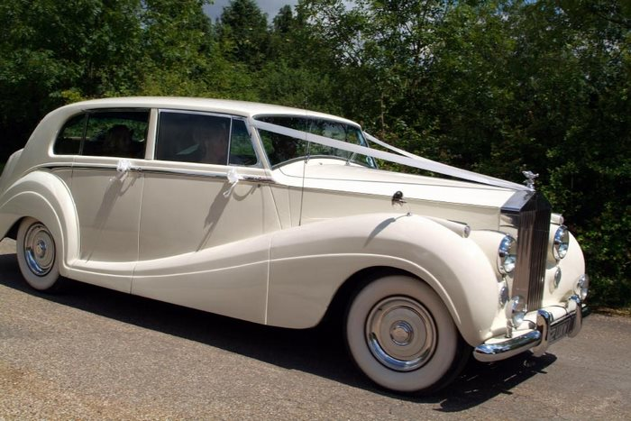 wedding photos involving vintage and classic wedding cars brides